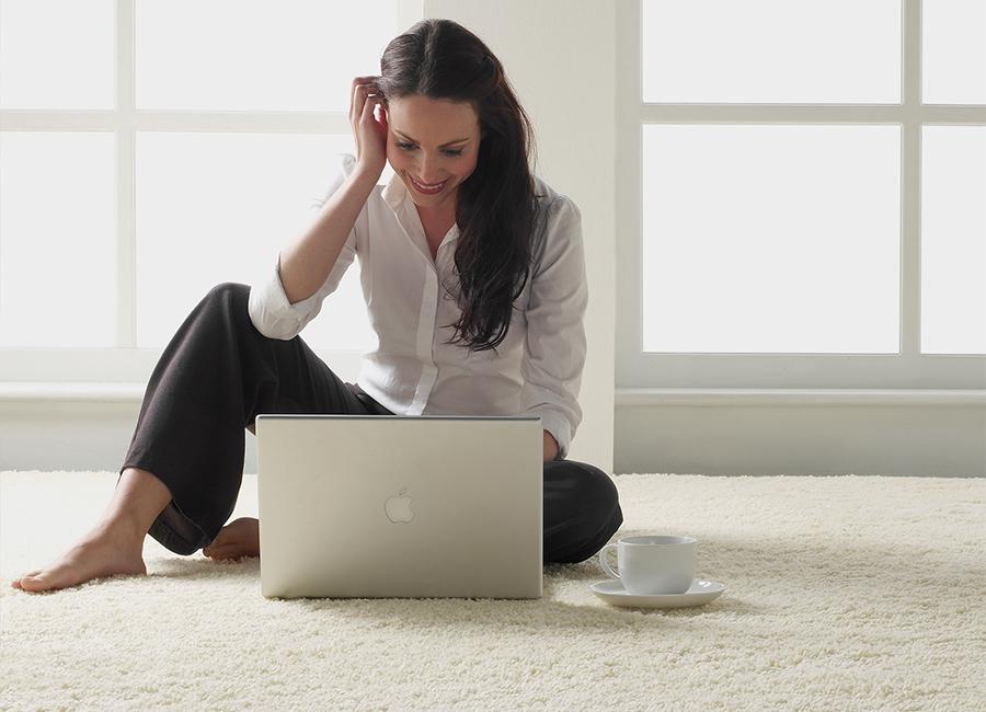 a woman sat on a custom made carpet
